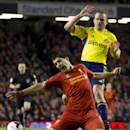 Liverpool's Luis Suarez, bottom, falls after a clash with Sunderland's Lee Cattermole during their English Premier League soccer match at Anfield Stadium, Liverpool, England, Wednesday March 26, 2014