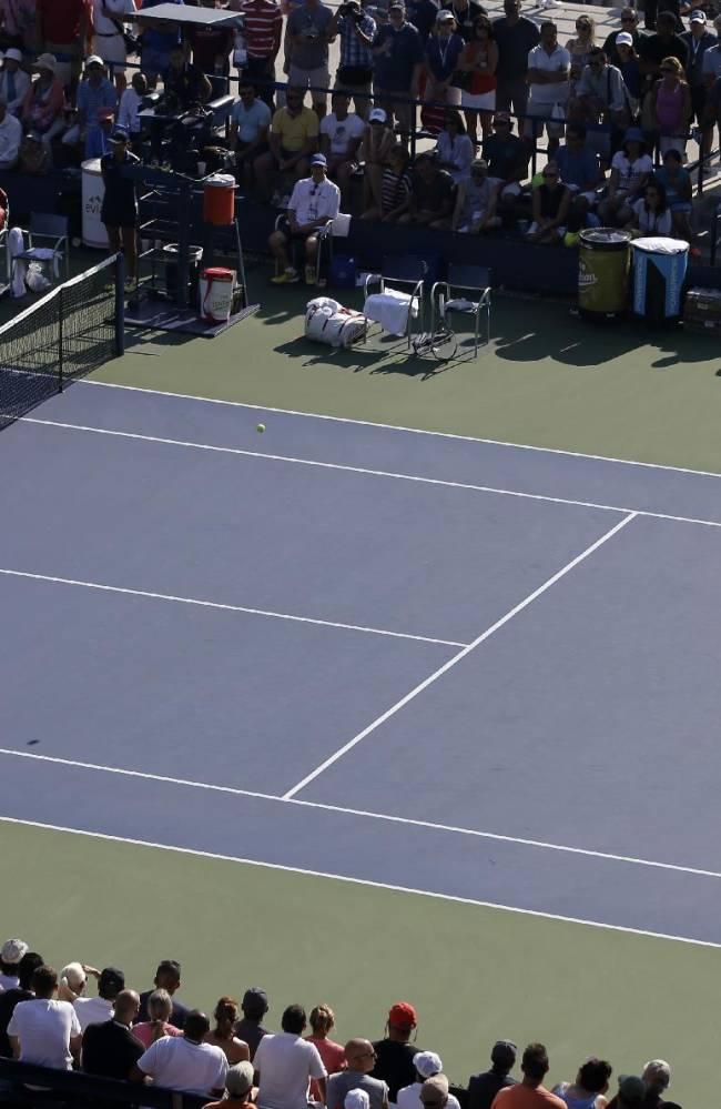 Camila Giorgi, of Italy, returns a shot to Anastasia Rodionova, of Australia, during the opening round of the 2014 U.S. Open tennis tournament, Monday, Aug. 25, 2014, in New York