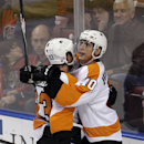 Philadelphia Flyers center Vincent Lecavalier (40) is congratulated by Jakub Voracek (93) after Lecavalier scored against the Florida Panthers in the third period of an NHL hockey game in Sunrise, Fla., Saturday, Nov. 1, 2014. The Panthers won 2-1 The Ass