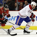 Montreal Canadiens left wing Brandon Prust (8), right, controls the puck against Chicago Blackhawks left wing Brandon Saad (20), left, and right wing Patrick Kane (88) during the first period of a preseason NHL hockey game in Chicago, Wednesday, Oct. 1, 2