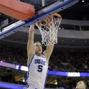Duke's Mason Plumlee, center, dunks the ball as Albany's Gary Johnson, left, and Blake Metcalf look on during the first half of a second-round game of the NCAA college basketball tournament, Friday, March 22, 2013, in Philadelphia. (AP Photo/Matt Slocum)