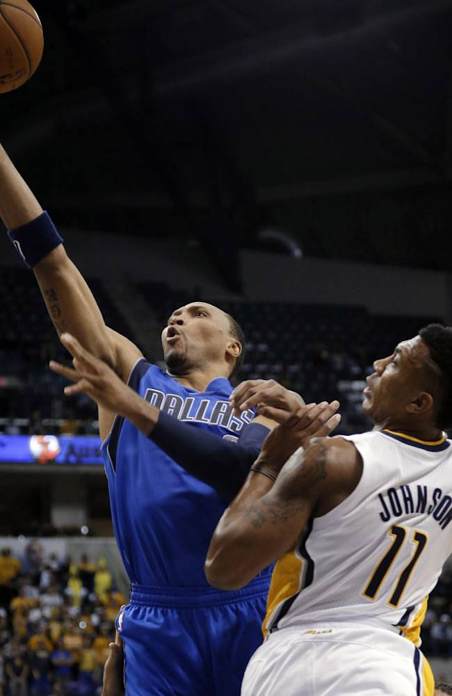 Dallas Mavericks forward Shawn Marion, left, shoots in front of Indiana Pacers guard Orlando Johnson during the first half of an NBA preseason basketball game in Indianapolis, Wednesday, Oct. 16, 2013