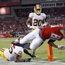 Tampa Bay Buccaneers wide receiver Solomon Patton (86) dives past Washington Redskins outside linebacker Adam Hayward (55) and cornerback Richard Crawford (20) to score on a 25-yard touchdown reception during the third quarter of an NFL preseason football