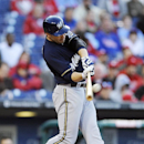 Milwaukee Brewers' Ryan Braun hits a three-run home run off Philadelphia Phillies reliever Brad Lincoln in the eighth inning of a baseball game Tuesday, April 8, 2014, in Philadelphia. The Brewers won 10-4 The Associated Press