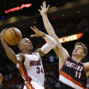 Miami Heat guard Ray Allen (34) goes up for a shot against Portland Trail Blazers center Meyers Leonard (11) during the first half of an NBA basketball game, Monday, March 24, 2014 in Miami The Associated Press