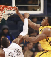Southern Mississippi's Michael Craig, right, dunks against Old Dominion's Richard Ross during the first half of an NCAA college basketball game Thursday, Jan. 23, 2014, in Norfolk, Va. (AP Photo/The Virginia-Pilot, L. Todd Spencer)
