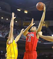 Arizona forward Brandon Ashley, right, puts up a shot as Southern California center Omar Oraby defends during the first half of an NCAA college basketball game, Sunday, Jan. 12, 2014, in Los Angeles. (AP Photo/Mark J. Terrill)