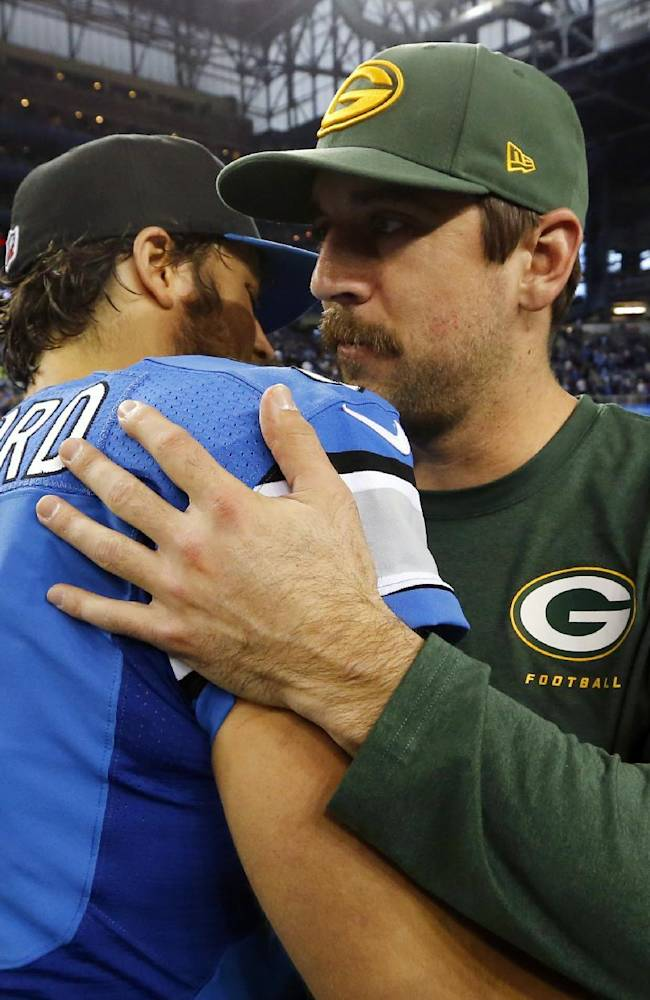 Detroit Lions quarterback Matthew Stafford (9) hugs Green Bay Packers quarterback Aaron Rodgers after an NFL football game at Ford Field in Detroit, Thursday, Nov. 28, 2013. The Lions won 40-10