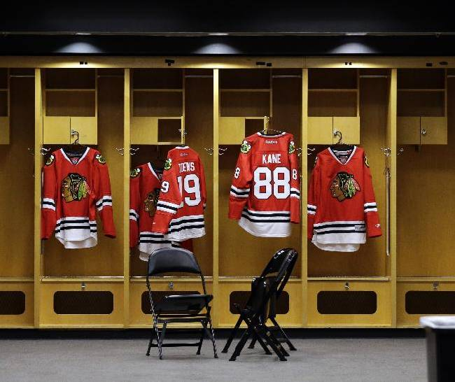 Chicago Blackhawks jerseys of Jonathan Toews (19) and Patrick Kane (88) hang in a locker room before an NHL hockey news conference at the United Center in Chicago, Wednesday, July 16, 2014. The Blackhawks recently agreed to eight-year contract extensions with Toews and Kane