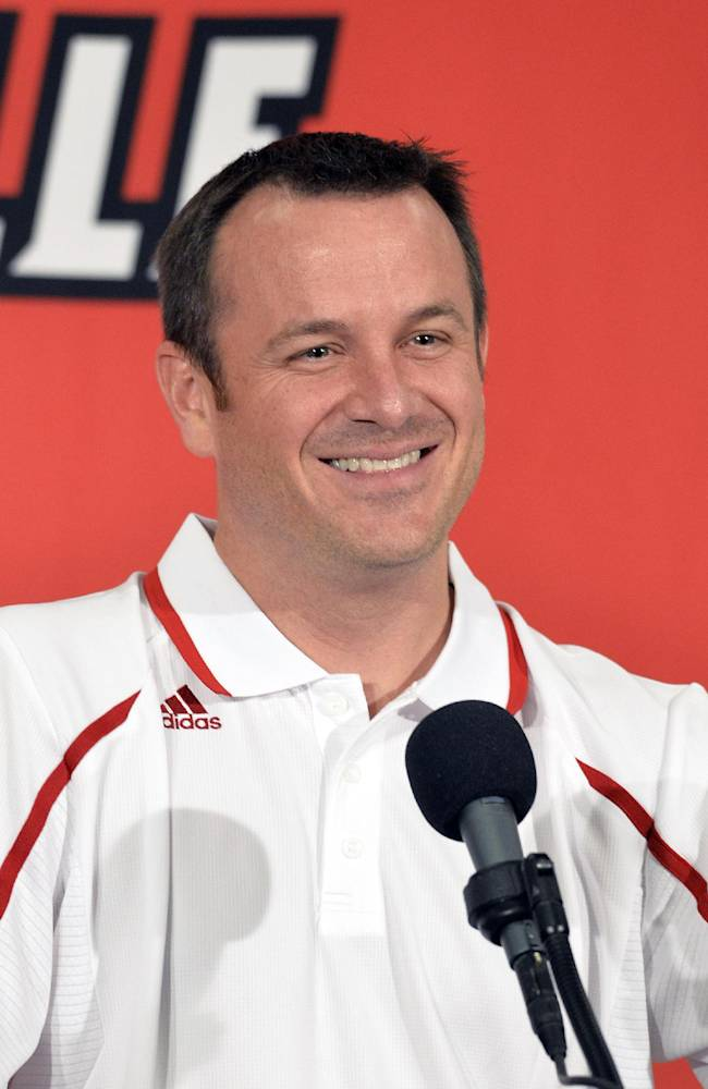 Louisville women's head basketball coach Jeff Walz reacts to a reporters question during NCAA college basketball media day Friday, Nov.1, 2013, in Louisville, Ky
