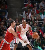 MILWAUKEE, WI - FEBRUARY 8: Dwight Howard #12 of the Houston Rockets posts up against Zaza Pachulia #27 of the Milwaukee Bucks on February 8, 2014 at the BMO Harris Bradley Center in Milwaukee, Wisconsin. (Photo by Gary Dineen/NBAE via Getty Images)