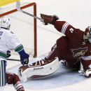 Phoenix Coyotes' Mike Smith, right, makes a save on a shot as Vancouver Canucks' Tom Sestito (29) watches during the third period of an NHL hockey game Tuesday, March 4, 2014, in Glendale, Ariz. The Coyotes defeated the Canucks 1-0 The Associated Press
