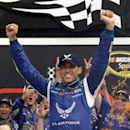 Aric Almirola celebrates in Victory Lane after winning the NASCAR Sprint Cup Series auto race at Daytona International Speedway in Daytona Beach, Fla., Sunday, July 6, 2014. (AP Photo/John Raoux)