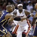 Miami Heat's LeBron James, middle, and Indiana Pacers' David West (21) watch the ball get away during the first half of an NBA basketball game, Friday, April 11, 2014, in Miami The Associated Press