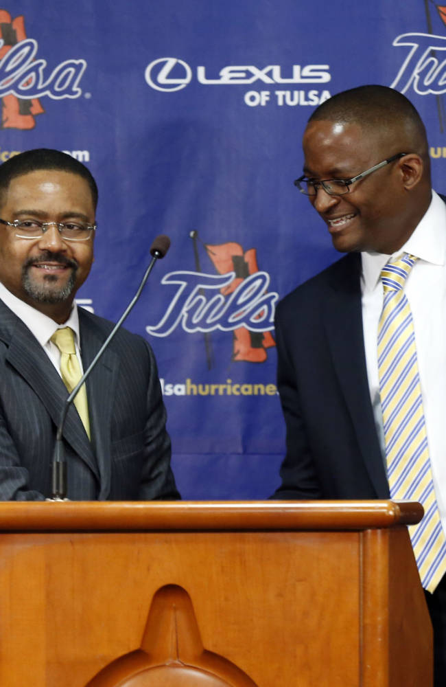 New Tulsa head basketball coach Frank Haith, left, is introduced by Tulsa director of athletics Derrick Gragg, right, in Tulsa, Okla., Friday, April 18, 2014