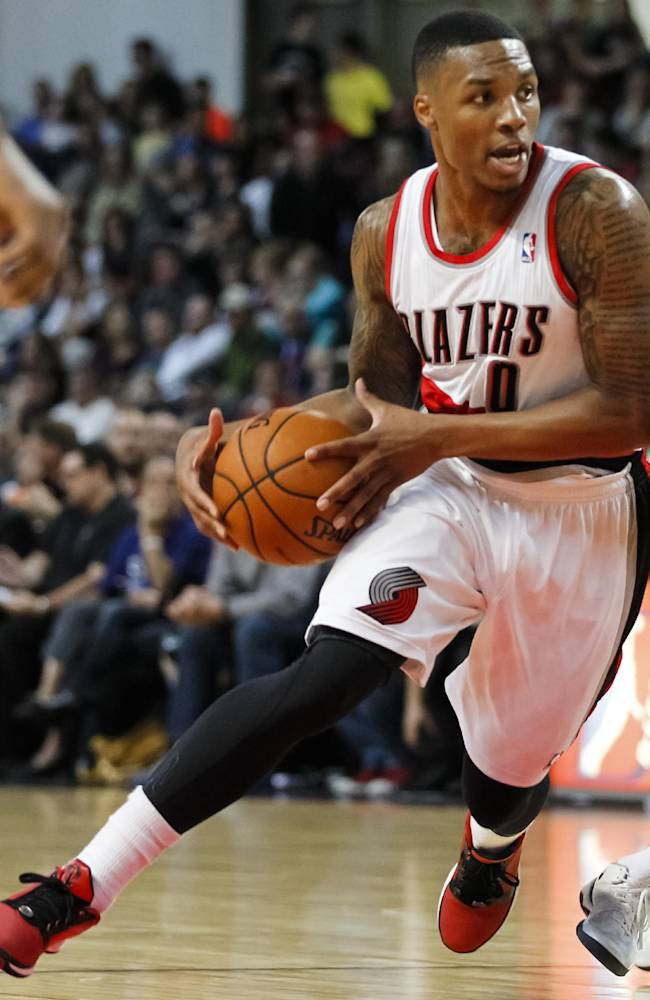 Portland Trail Blazers point guard Damian Lillard (0) moves the ball against the Utah Jazz in the second half of a preseason NBA basketball game on Friday, Oct. 11, 2013, in Boise, Idaho. Portland won 96-86