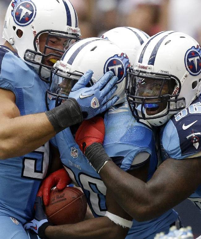 In this Sept. 15, 2013, file photo, Tennessee Titans' Alterraun Verner, center, celebrates with teammates after he returned an interception for a touchdown during the fourth quarter of an NFL football game against the Houston Texans in Houston. The Kansas City Chiefs and the Titans are tied for the most takeaways in the NFL. Well, actually Titans safety Michael Griffin says it's mostly cornerback Alterraun Verner, who leads the league with six takeaways all by himself