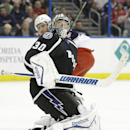 Tampa Bay Lightning goalie Ben Bishop (30) makes a save on a shot by Columbus Blue Jackets center Brian Gibbons (23) during the first period of an NHL hockey game Saturday, Dec. 6, 2014, in Tampa, Fla The Associated Press