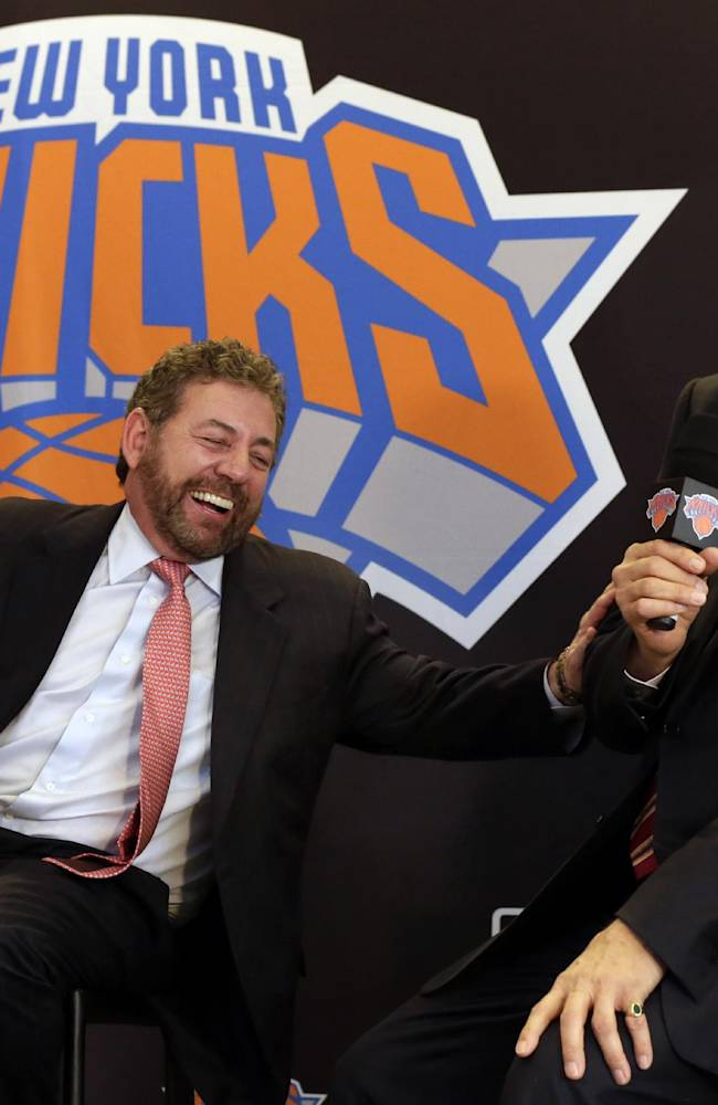 New York Knicks new team president Phil Jackson, right, and team owner James Dolan share a light moment during a news conference where Jackson was introduced, at New York's Madison Square Garden, Tuesday, March 18, 2014. Jackson signed a five-year contract that will reportedly pay him at least $12 million annually and said he will spend significant time in New York