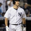 New York Yankees' Mark Teixeira watches his two-run home run off Boston Red Sox pitcher Vicente Padilla during the eighth inning of the baseball game at Yankee Stadium in New York, Saturday, July 28, 2012. The Red Sox won 8-6. (AP Photo/Seth Wenig)