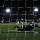 West Ham's Mark Noble, center, scores his side's first goal from the penalty spot past Hull City's goalkeeper Steve Harper during the English Premier League soccer match between West Ham and Hull City at Upton Park stadium in London, Wednesday, March 26,