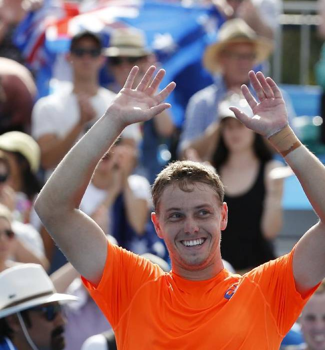James Duckworth of Australia celebrates after beating Blaz Kavcic of Slovenia during their first round match at the Australian Open tennis championship in Melbourne, Australia, Monday, Jan. 19, 2015