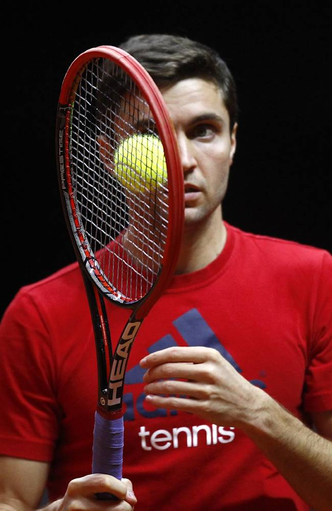 France's Gilles Simon watches the ball during a training session at the Pierre Mauroy stadium in Lille, northern France, Wednesday, Nov.19, 2014. France will face Switzerland in the Davis Cup final starting next Friday