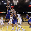 Los Angeles Clippers' Chris Paul, left, goes up for a layup past Golden State Warriors' David Lee (10), teammate Blake Griffin (32) and the Warriors' Draymond Green (23) during the second half in Game 3 of an opening-round NBA basketball playoff series on