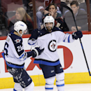 Winnipeg Jets center Mathieu Perreault (85) celebrates with Blake Wheeler (26) after scoring a goal during the third period of an NHL hockey game against the Arizona Coyotes, Thursday, Jan. 8, 2015, in Glendale, Ariz. The Coyotes won 4-1 The Associated Pr