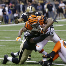 Cincinnati Bengals running back Jeremy Hill (32) carries as New Orleans Saints nose tackle Brodrick Bunkley (77) tackles in the first half of an NFL football game in New Orleans, Sunday, Nov. 16, 2014 The Associated Press