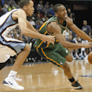 Utah Jazz guard Alec Burks, right, loses control of the ball against Memphis Grizzlies forward Tayshaun Prince, left, in the second half of an NBA basketball game on Wednesday, March 19, 2014, in Memphis, Tenn. The Grizzlies won 96-86 The Associated Press