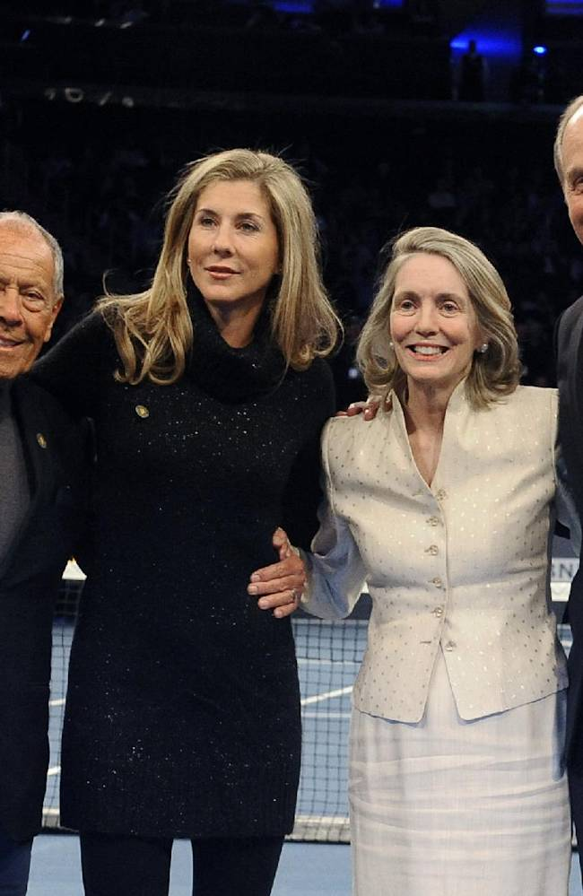 Tennis coach Nick Bollettieri, left, former tennis player Monica Seles, second from left, former head of the U.S. Tennis Association Jan Brown Grimes, and International Tennis Hall of Fame President Stan Smith stand on the court at the BNP Paribas Showdown Tennis Tournament, on Monday, March 3, 2014, in New York