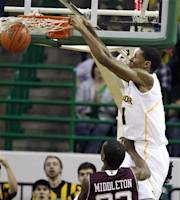 Baylor's Perry Jones (1) dunks over Texas A&M's Khris Middleton (22) in first half of an NCAA college basketball game Monday, Jan. 2, 2012, in Waco, Texas. ( AP Photo/Duane A. Laverty)