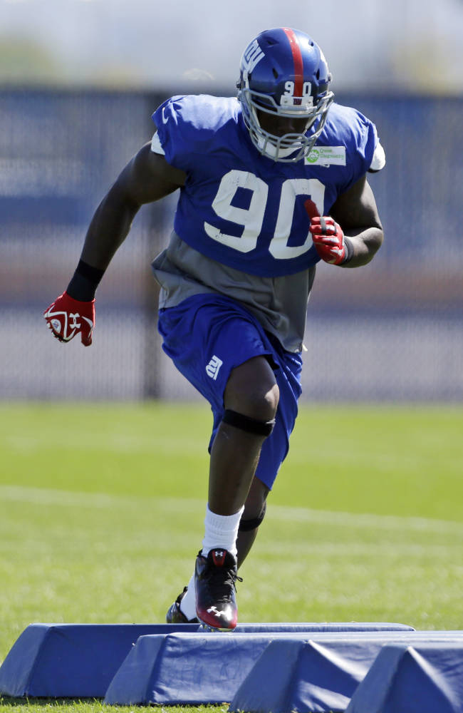 In this photo taken Wednesday, Sept. 18, 2013, New York Giants defensive end Jason Pierre-Paul works out during NFL football practice in East Rutherford, N.J.,. Two weeks into the season, the Giants are still looking for a pass rush. The defensive line will have another chance on Sunday, when they travel to face the Carolina Panthers
