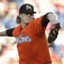 Phillies beat Marlins 5-3 in 14 innings The Associated Press