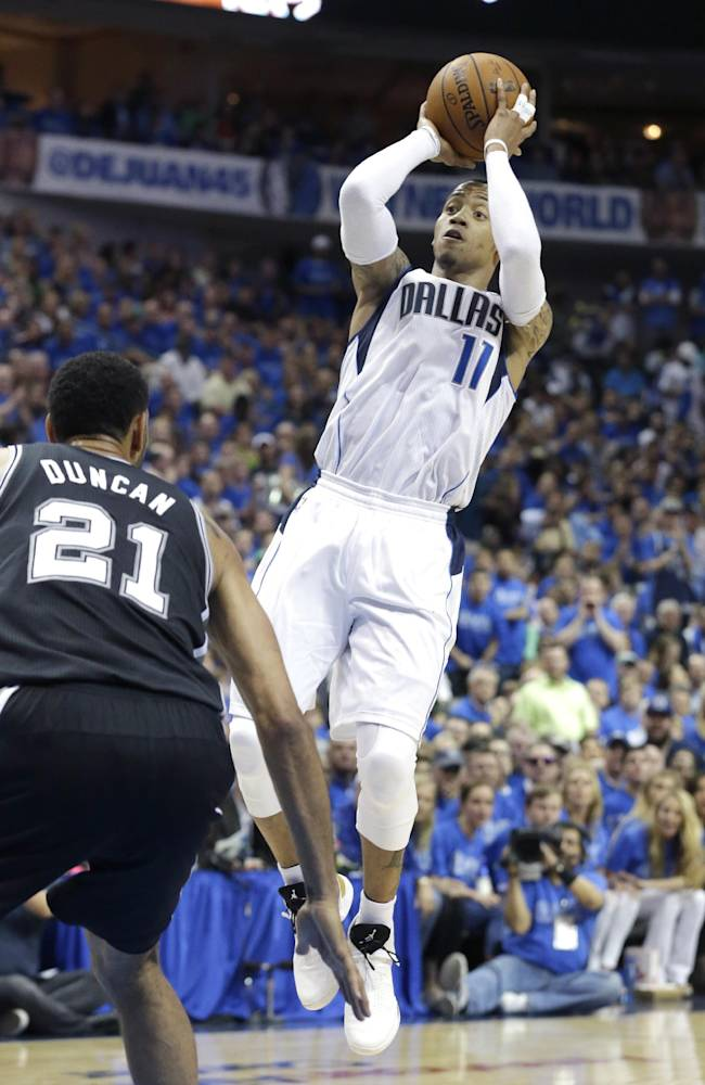 Dallas Mavericks guard Monta Ellis (11) shoots over San Antonio Spurs forward Tim Duncan (21) during the first half in Game 3 in the first round of the NBA basketball playoffs in Dallas, Saturday, April 26, 2014