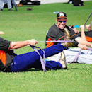 Miami Marlins catcher Jarrod Saltalamacchia, left, raided teammate Jose Fernandez's, right, locker and decided to wear Fernandez's jersey, purple jeans and gold high top sneakers to the Marlins morning stretch during a spring training baseball workout, Fr