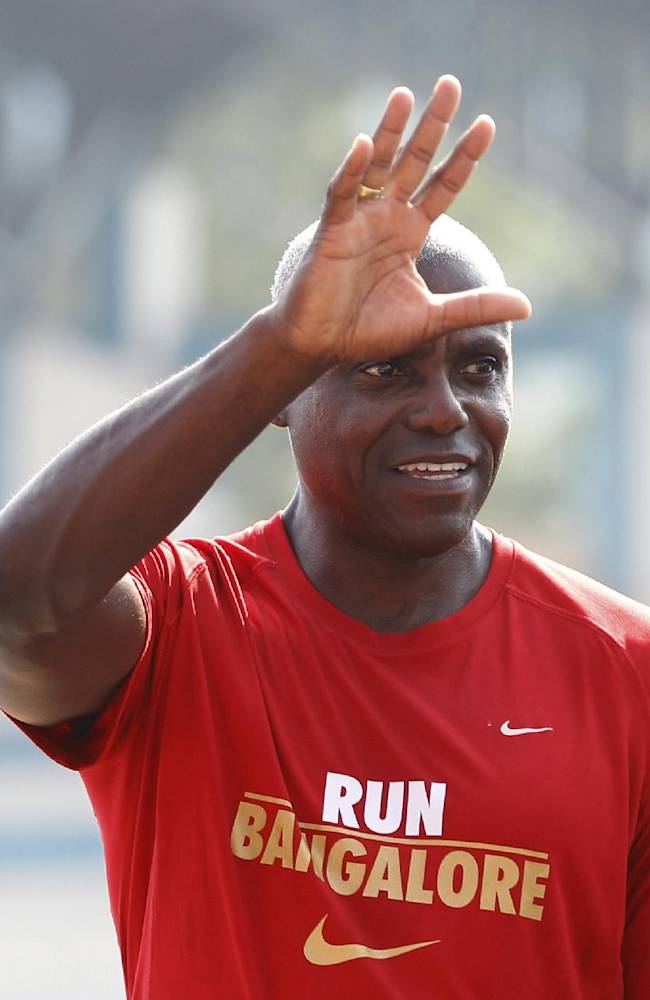 U.S. Olympian Carl Lewis, waves to the participants at the TCS World 10K Bangalore 2014 run in Bangalore, India, Sunday, May 18, 2014. According to organizers, the event had eight races with total prize money of USD 170,000