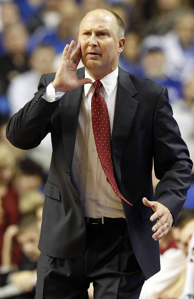 Transylvania head coach Brian Lane shout to his team during the second half of an NCAA basketball exhibition game against Kentucky, Friday, Nov. 1, 2013, in Lexington, Ky. Kentucky won 76-42