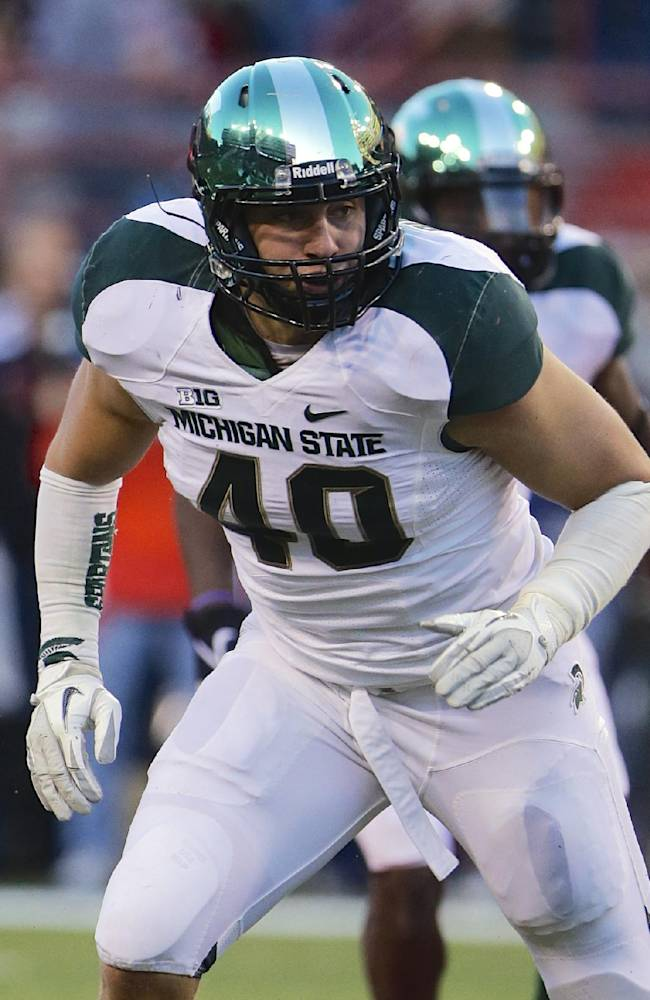 In this Nov. 16, 2013, photo, Michigan State linebacker Max Bullough (40) runs in the second half of an NCAA college football game against Nebraska in Lincoln, Neb.  Michigan State has suspended senior linebacker Bullough for violating team rules, making him ineligible to play in the Rose Bowl. In a news release sent early Thursday, Dec. 26, Spartans coach Mark Dantonio said Bullough had been suspended for the rest of the season. He did not say what rules the two-time team captain violated