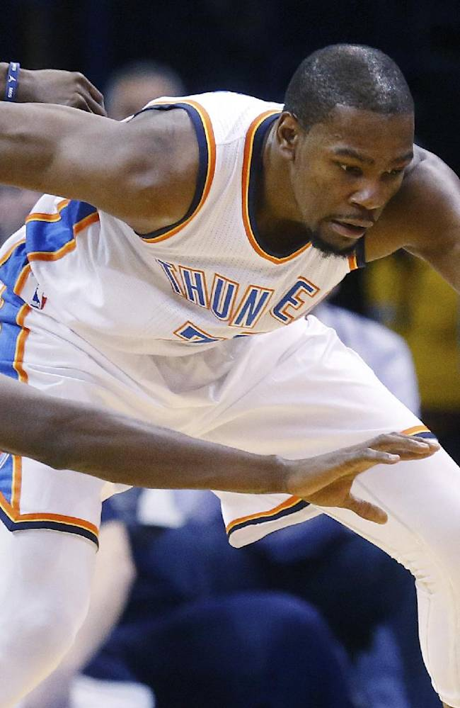Oklahoma City Thunder forward Kevin Durant (35) keeps the ball away from Charlotte Bobcats forward Michael Kidd-Gilchrist (14) during the first quarter of an NBA basketball game in Oklahoma City, Sunday, March 2, 2014