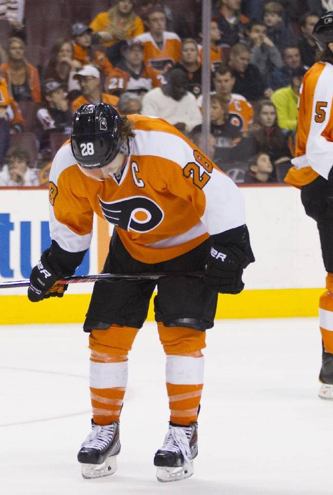 Philadelphia Flyers' Claude Giroux, left, and Braydon Coburn, right, reacts to an empty-net goal by the Tampa Bay Lightning during the third period of an NHL hockey game Saturday, Jan. 11, 2014, in Philadelphia. The Lightning won 6-3