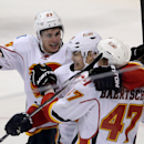 Calgary Flames' Sean Monahan (23), Jiri Hudler (24), and Sven Baertschi (47) celebrate a goal by Hudler against the Winnipeg Jets' during third period NHL hockey action in Winnipeg Monday, Nov. 18, 2013 The Associated Press