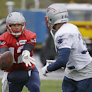 New England Patriots quarterback Tom Brady (12) pitches a ball to New England Patriots running back Shane Vereen (34) during practice at the NFL football team's facility Wednesday, Dec. 10, 2014 in Foxborough, Mass. The Patriots will play the Miami Dolphi