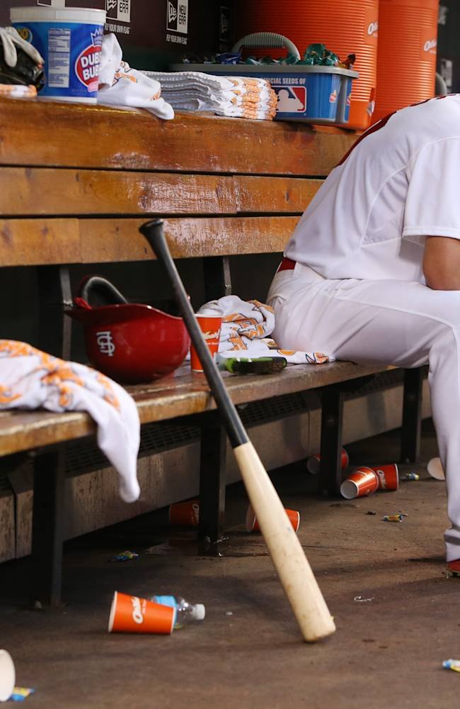 In this May 12, 2014 photo, St. Louis Cardinals starting pitcher Tyler Lyons sits in the dugout after allowing seven runs in the first two innings against the Chicago Cubs, at Busch Stadium in St. Louis. The Cubs beat the Cardinals 17-5