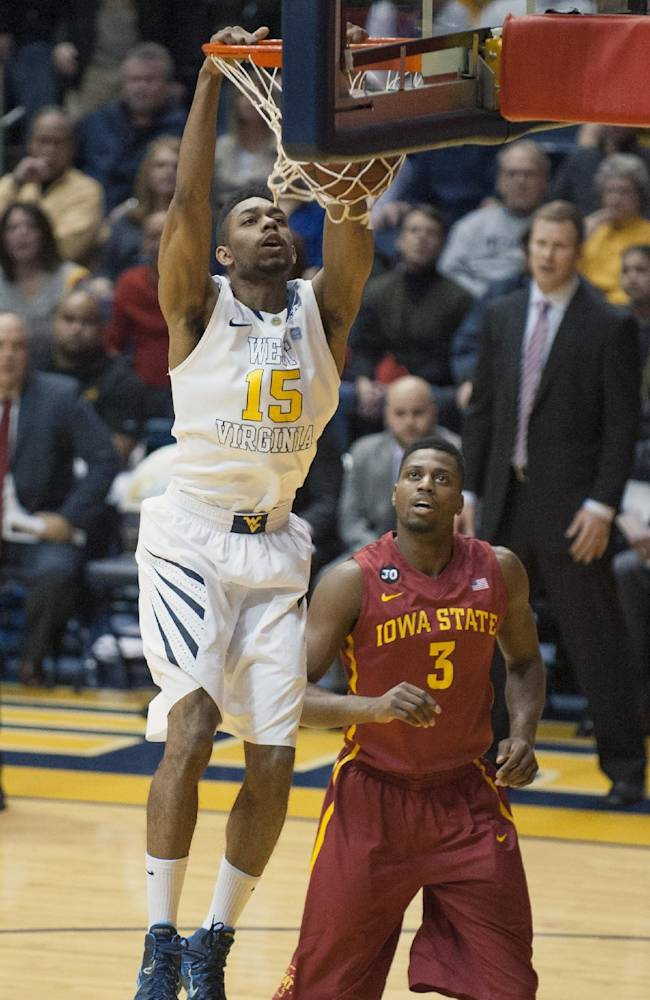 West Virginia's Terry Henderson (15) dunks during the first half of an NCAA college basketball game against Iowa State, Monday, Feb. 10, 2014, in Morgantown, W.Va