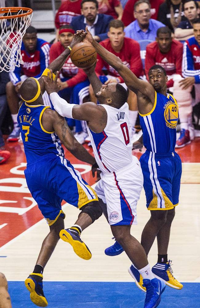 Los Angeles Clippers forward Glen Davis (0) goes up for a lay up against Golden State Warriors forwards Jermaine O'Neal (7), and Harrison Barnes (40)  during the first halff of Game 7 of a first-round NBA basketball playoff series, Saturday, May 3, 2014, in Los Angeles
