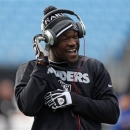 FILE - In this Dec. 23, 2012, file photo, Oakland Raiders running back Mike Goodson laughs as he warms up before an NFL football game against the Carolina Panthers in Charlotte, N.C. Goodson, who came to the New York Jets this offseason after a year in Oakland, is facing drug and weapons charges after a New Jersey traffic stop on Friday, May 17, 2013, State police said. (AP Photo/Bob Leverone, File)