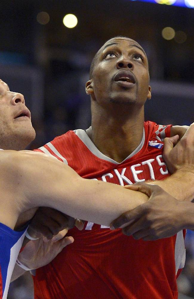 Los Angeles Clippers forward Blake Griffin, left, and Houston Rockets center Dwight Howard battle for a rebound during the second half of an NBA basketball game, Wednesday, Feb. 26, 2014, in Los Angeles