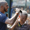 Indians owner gets head shaved The Associated Press